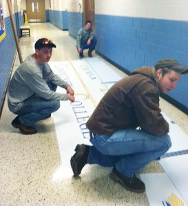 Students construct sign