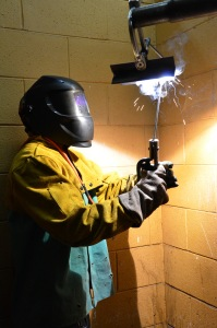 The welding lab at Patrick Henry Community College is where Ray Pierce spends most of his time on campus. He's pictured completing an overhead weld in one of the lab's welding stations.